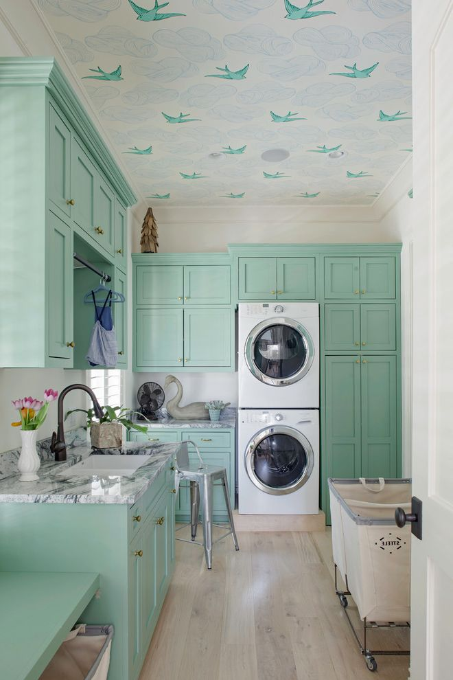 Wallpaper on ceiling and teal wallpaper