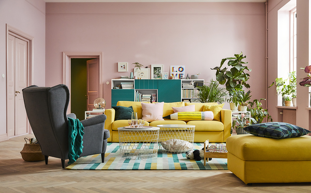 pink walls, yellow couch and turquoise accents. Pink, yellow, turquoise, gray color palette