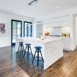Modern lighting in kitchen with white, marble counters
