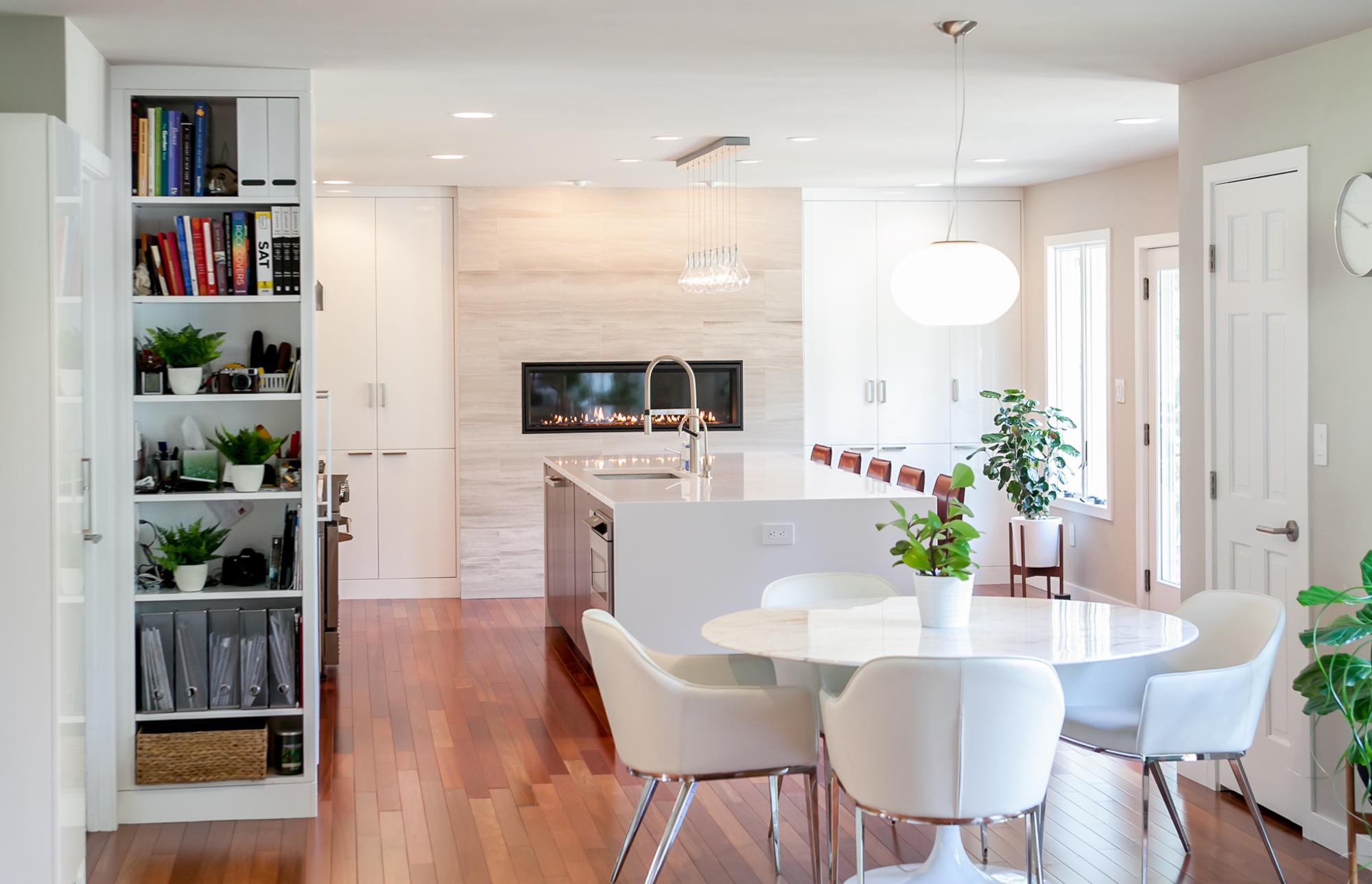 White furniture with bookshelf outside of kitchen