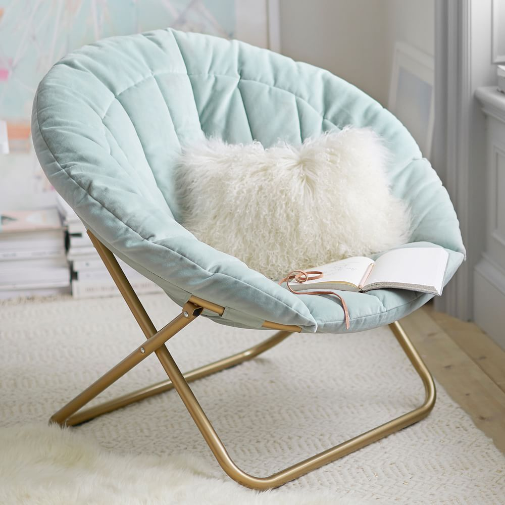 A round, teal, plush saucer chair
